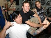 Members of the rock band Blink-182 sit at the ship?s controls pier-side aboard the nuclear-powered attack submarine USS Memphis (SSN 691). Morale Welfare and Recreation, Naval Personnel Command Millington, Tenn. and MWR, NSA Bahrain brought Blink-182 to B
