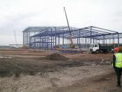English: Warehousing Construction. Steelwork nearing completion for a warehouse on the site of the former Hem Heath colliery.