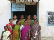 English: Board members stand in front of their 'thrift cooperative' in Mulukanoor, Andhra Pradesh.