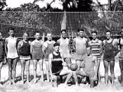 Beach volleyball players at the Outrigger Canoe Club on Waikiki Beach in Honolulu, Hawai'i. Duke Kahanamoku is at far right.