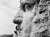 Construction at Mount Rushmore of George Washington's likeness.