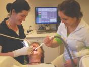 English: A Dentist and her Dental assistant