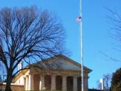 Arlington House flag flying at half-staff. The flag is lowered during interments.
