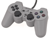 English: An original Sony PlayStation DualShock controller for the PlayStation video game console. This became the standard pack-in controller after its introduction, and replaced the non-analog controller.