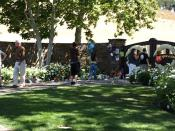 English: A group of fans visiting the make-shift Michael Jackson memorial in front of the gated entrance to Neverland Ranch three days after the musician had passed away.