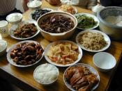 Chinese meal in Suzhou with rice, shrimp, eggplant, fermented tofu, vegetable stir-fry, vegetarian duck with meat and bamboo