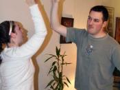 English: A woman and a man performing a high five.