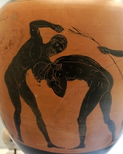 Two athletes competing in the pankration. Panathenaic amphora, made in Athens in 332-331 BC, during the archonship of Niketes. From Capua.