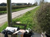 English: Reduce, Reuse, Recycle Waste items await the recycling lorry at the entrance to Lower Dean Farm. The low wooden sign behind the boxes carries the words 'short cut', which refers to the Stewkley Circular Walk. Those wishing to walk a shorter dista
