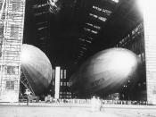 German Dirigible Graf Zeppelin (LZ-127) (at right) in the airship hangar at Naval Air Station Lakehurst, New Jersey. Photo is dated 7 August 1929. Also in the hangar is USS Los Angeles (ZR-3), which had been built in Germany as Zeppelin airship LZ-126.
