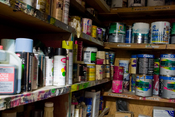 A collection of cans of paint and other related materials.
