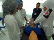 US Navy 050301-N-8629M-332 An Indonesian nurse practices cardio pulmonary resuscitation (CPR) under the instruction of Hospital Corpsman 3rd Class Lynette Shute