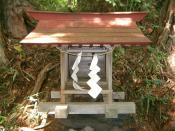 Typical Shinto shrine with paper streamers made out of unprocessed hemp fibre.