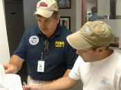 English: Biloxi, Miss., September 8, 2005 -- FEMA Public Information Officer (PIO) Gene Romano speaks about the FEMA recovery process to the news director of a local radio station. Public Information Officers strive to get the word out to all residents in