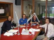 English: Dunkirk, NY, October 7, 2009 --Federal disaster representatives Alberto Pillot, FEMA PIO, Carl Sherrill, SBA PIO, and Deborah Farmer, FEMA NFIP Specialist participate in a radio program at WDOE radio in Dunkirk, NY discussing recovery operations