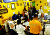 Members of the United States Navy serve the homeless at Dorothy's Soup Kitchen in Salinas, California
