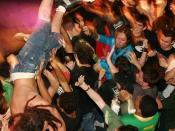 A man crowdsurfing in a moshpit, uploaded from flickr