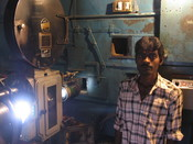 Projectionist in the projection room of the Elgin Talkies cinema hall in Bangalore. Elgin Talkies is oldest cinema hall in operation in bangalore. The building was build in 1896, the year cinema was introduced in India by the Lumiere Brothers. According t