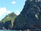 English: Castle Rock and Rugged Jack. Viewed from the Exmoor Coastal Cruise boat