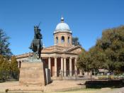 Parliament building in Bloemfontein, South Africa, with monument to Christiaan de Wet.