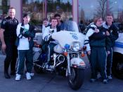 Washington Special Olympic Athletes and Redmond Police Officer at a fundraising & awareness event