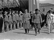 Adolf Hitler and Benito Mussolini walking in front of saluting military during Hitler's visit to Venice, Italy.