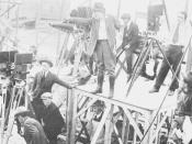 English: Original caption: Cecil B. de Mille directing a scene with four Pathé professional cameras and a Bell and Howell trained on the set.