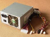 ATX computer power supply with connectors for the mother board, fans, and various storage drives. Connectors from left to right: 20-pin ATX motherboard connector (ATX 1.0), 4-pin