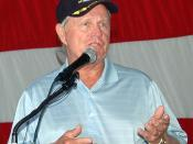 060927-N-4549D-002 Golfer Jack Nicklaus fields questions from Mayport-area sailors who filled the hangar bay of the USS John F. Kennedy (CV-67) to see the golfer. During his visit to the Naval Station, Nicklaus met with Mayport-area Sailors and received a