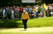 Jack Nicklaus walks up to his ball on the 9th hole of the par-3 course at Augusta National Golf Club during the 2006 par-3 contest. Nicklaus was playing along with Andy North and Tom Watson as a non-competitor in the contest. Nicklaus had his grandson tak