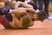 Two high school students competing in scholastic wrestling (collegiate wrestling done at the high school and middle school level).