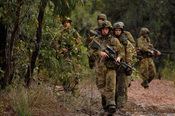 Australian Army soldiers conducting a foot patrol during a joint training exercise with US forces in Shoalwater Bay (2007).