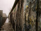 English: A view of the East side of the Berlin Wall, taken in 1990 (after the border was opened). The graffiti seen in the photo would date from after the border was opened. Most sections of the Berlin Wall were damaged by both local residents and tourist