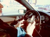 Driver in a Mitsubishi Galant using a hand held mobile phone violating New York State law.