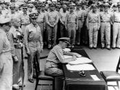 English: Admiral Chester Nimitz signs as Supreme Allied Commander during formal surrender ceremonies on the USS MISSOURI in Tokyo Bay. September 2, 1945. Directly behind him are (left-to-right): General Douglas MacArthur; Admiral William Halsey, USN, and