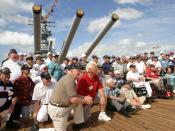 US Navy 030902-N-3228G-003 Former crewmembers of the Battleship Missouri (BB 63) pose for photos