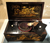 Tea caddy, Chinese, circa 1780, with caddy spoon by silversmith Elizabeth Morley, 1805. Exhibit in the Indianapolis Museum of Art, Indianapolis, Indiana, USA.