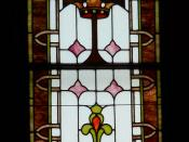 English: Stained glass window depicting the Cross and the Crown in All Saints Episcopal Church, Jensen Beach, Florida, dedicated to the memory of Katherine Dunn. TEXT: