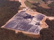 English: 2002 aerial view of the Maxey Flats Disposal Site. The geomembrane interim cover and East Detention Basin are under construction.