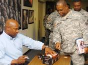 English: Football and baseball great Bo Jackson paid a visit to Third Army Headquarters, Sept. 12, at Fort McPherson, Ga., to sign autographs, shake hands and take pictures with Soldiers assigned to