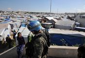 Português do Brasil: Porto Príncipe - No acampamento Jean Marie Vincent, militares das tropas brasileiras da Missão das Nações Unidas para a Estabilização do Haiti fazem a patrulha por causa das eleições que foram realizadas em novembro de 2010. Dias ante