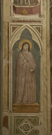 Clare of Assisi holding a lily, fresco byGiotto di Bondone in the Bardi chapel of the Basilica di Santa Croce in Florence, Italy.