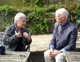 English: Two people in a CCI (Co-Counselling International) session, the woman is in the role of