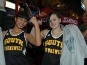 Natalie Negrotti and Jennifer Zelaya of South Brunswick High School in New Jersey flex their muscles after maxing the female flexed arm hang. Both young women proceeded to do dead hang pull-ups to demonstrate their physical fitness at the second annual Ma