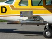 Cessna 210, rebuilt for cloud seeding, with detail view of silver iodide generator