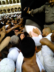 Muslims jostle for a chance to touch the black stone embedded in the eastern corner of the Kaaba.