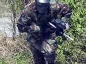 US Navy 050408-N-7293M-032 A student assigned to Mobile Security Squadron Seven (MSS-7), charges forward during a force-on-force combat exercise using paintball equipment. MSS-7