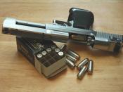 English: Desert Eagle Pistol beside Speer box of 325 Grain Hollowpoints