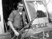 English: A1C William Pitsenbarger with an M-16 outside the HH-43.