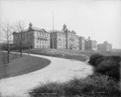 English: University of Cincinnati, Ohio. c.1904. Looking up a hill toward buildings.